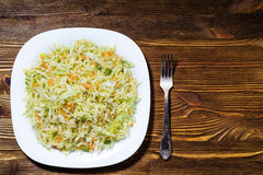 Fresh vegetable salad with cabbage, carrots, green onions and di Royalty Free Stock Images