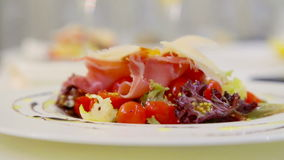 Fresh vegetable salad with cheese and bacon.Lettuce leaves, tomatoes and cheese. stock video footage