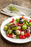 Fresh vegetable salad with cheese and olives Stock Photo