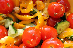 Fresh vegetable salad. Fresh salad with cherry tomato, cucumbers and flax-seed Stock Images