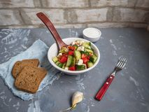 Fresh vegetable salad with feta cheese, two slices of bread stock photos