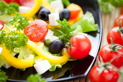 Fresh vegetable salad with feta and olives Royalty Free Stock Image