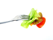 Fresh vegetable salad on fork Stock Photo