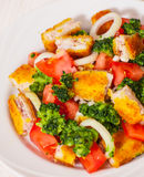 Fresh vegetable salad with fried breaded fish fillets Stock Images