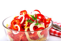 Fresh vegetable salad in a glass dish on a white background. Royalty Free Stock Photography