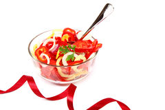 Fresh vegetable salad in a glass dish on a white background. Royalty Free Stock Photo