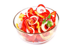 Fresh vegetable salad in a glass dish on a white background. Stock Images