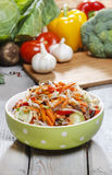 Fresh vegetable salad in green dotted bowl Royalty Free Stock Photo