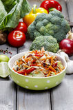 Fresh vegetable salad in green dotted bowl Royalty Free Stock Images
