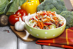 Fresh vegetable salad in green dotted bowl Royalty Free Stock Image
