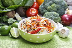 Fresh vegetable salad in green dotted bowl Stock Photography