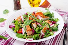 Fresh vegetable salad with grilled chicken breast   - tomatoes, cucumbers, radish and mix lettuce leaves. Chicken salad. Healthy food Royalty Free Stock Photography