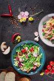 Fresh vegetable salad with grilled chicken breast - tomatoes, radish and mix lettuce leaves. Chicken salad. Healthy food. Black ba. Ckground. Top view Royalty Free Stock Images