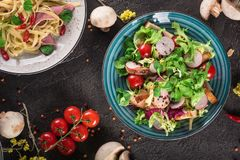 Fresh vegetable salad with grilled chicken breast - tomatoes, radish and mix lettuce leaves. Chicken salad. Healthy food. Black ba. Ckground. Top view Stock Image