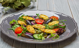 Fresh vegetable salad, healthy food, organic cucumbers,nmussels, tomatoes and salad leaves Stock Images