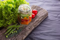 Fresh vegetable salad with herbs on a wooden board stock photography