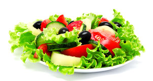 Fresh vegetable salad isolated on a white Stock Images