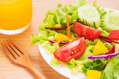 Fresh vegetable salad and juice Stock Photography