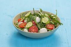 Fresh vegetable salad with mozzarella and arugula Stock Photo