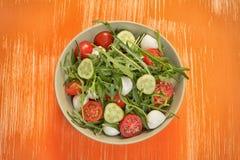 Fresh vegetable salad with mozzarella and arugula Royalty Free Stock Image