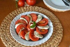 Fresh vegetable salad with mozzarella, tomato and basil Stock Photo