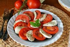 Fresh vegetable salad with mozzarella, tomato and basil Stock Photos