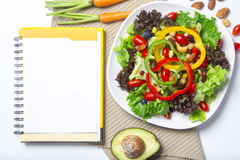 Fresh vegetable salad with notebook paper Royalty Free Stock Images