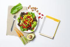 Fresh vegetable salad with notebook paper Stock Photos