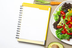 Fresh vegetable salad with notebook paper Stock Images