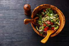 Fresh vegetable salad in olive wood bowl Stock Photo