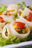 Fresh vegetable salad with pasta lumakoni vertical Royalty Free Stock Photography