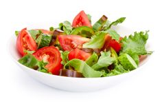 Fresh vegetable salad in a plate isolated on white background. Fresh vegetable salad in a plate isolated on a white background stock photo