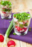 Fresh vegetable salad with radish in transparent glass. Food Royalty Free Stock Photo
