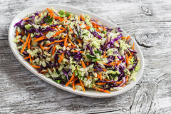 Fresh vegetable salad with red cabbage, carrots, sweet peppers, herbs and seeds. Healthy vegetarian food. Royalty Free Stock Photos