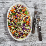 Fresh vegetable salad with red cabbage, carrots, sweet peppers, herbs and seeds. Healthy vegetarian food. Stock Photos