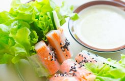 Fresh vegetable salad roll with crab stick eating with spicy sal Stock Photography