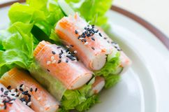 Fresh vegetable salad roll with crab stick eating with spicy sal Royalty Free Stock Images