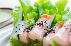 Fresh vegetable salad roll with crab stick eating with spicy sal Stock Images