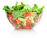 Fresh vegetable salad in transparent bowl  on white Royalty Free Stock Images