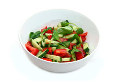 Fresh vegetable salad in white bowl. On white background Royalty Free Stock Images