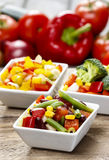 Fresh vegetable salad in white bowl. Spring party table. Royalty Free Stock Photo