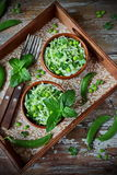 Fresh vegetable salad with white cabbage, green peas and mint Stock Image