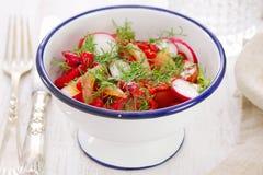 Fresh vegetable salad on white dish. On white wooden background Stock Photo