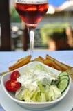 Fresh vegetable salad and wine stock photos