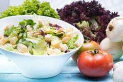 Fresh vegetable salad on wood vintage table Stock Photography