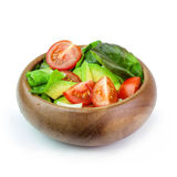 Fresh vegetable salad in wooden bowl Isolated on white backgroun. Fresh vegetable salad of salad leaves and tomatoes Stock Images