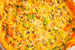 Fresh vegetable and salmon quiche tart close-up Royalty Free Stock Image