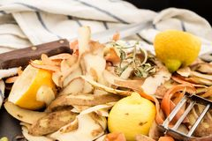 Fresh vegetable scraps with peeler, knife and towel. Fresh vegetable scraps with peeler, knife and towel, house waste/compost management concept Stock Image