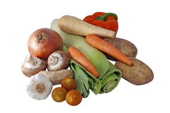 Fresh Vegetable Selection. Including onions, garlic, tomatoes, ginger, mushrooms, leek, carrots, parsnip, bell pepper and potatoes on an isolated white Stock Photo