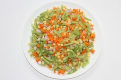 Fresh vegetable slices in a plate. With white background Stock Images